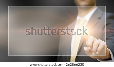 Businessman using digital interface with his fingers - stock photo