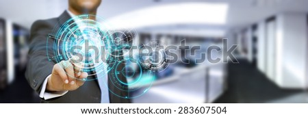 Businessman using digital interface with his fingers in his office - stock photo