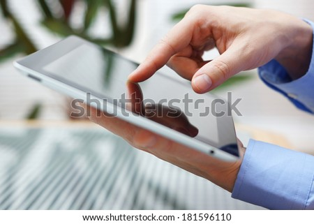 businessman using digital tablet, closeup - stock photo
