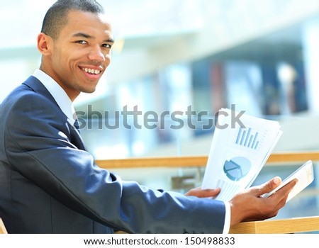 Businessman using digital tablet computer with documents. New technologies for success workflow concept.