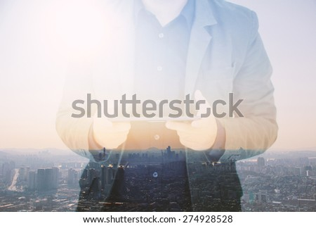 Businessman using digital tablet,double exposure of businessman blur background. - stock photo