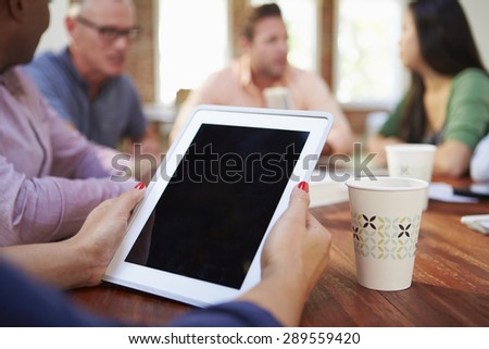 Businessman Using Digital Tablet In Meeting - stock photo