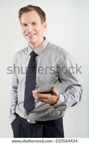 businessman using electronic tablet on white background - stock photo