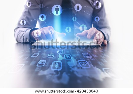Businessman using futuristic tablet computer, pressing People icon on the touchscreen. Recruitment, Human Resources concept. - stock photo