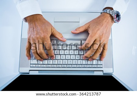 Businessman using his laptop in office
