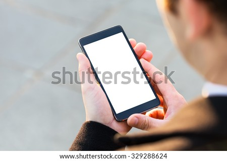Businessman using his Mobile Phone outdoor, close up - stock photo