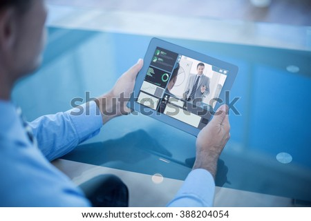 Businessman using his tablet against white background with vignette - stock photo