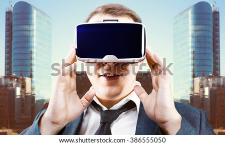 Businessman using his Virtual Reality VR glasses head mounted display