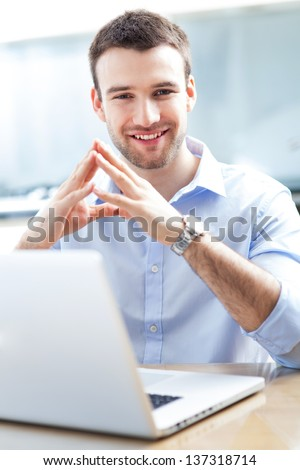 Businessman using laptop - stock photo