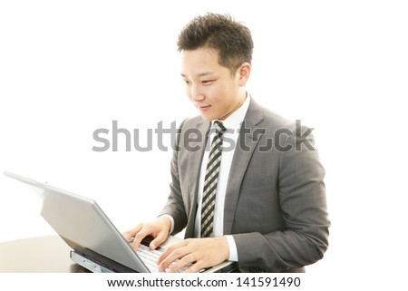 Businessman using laptop,