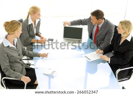 Businessman using laptop at a corporate meeting