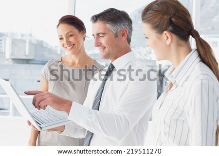 Businessman using laptop at work to showing notes