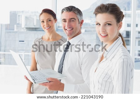 Businessman using laptop at work to showing notes - stock photo