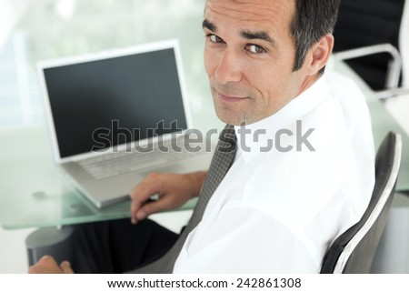 businessman using laptop at workplace - stock photo