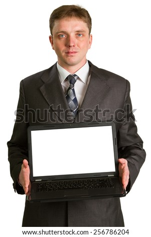 Businessman using laptop computer, smiling. Isolated on white background. - stock photo