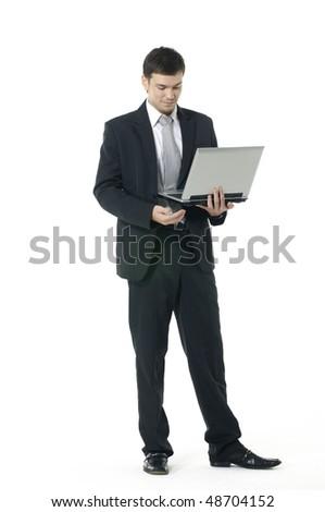 Businessman using laptop computer standing - stock photo