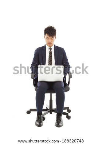 businessman using laptop on the chair - stock photo