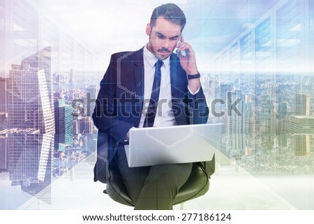 Businessman using laptop while phoning against digitally generated server room with towers - stock photo