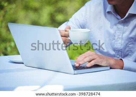 Businessman using laptop with coffee in a restaurant