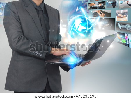 Businessman using laptop with glowing globe.Business connection concept.