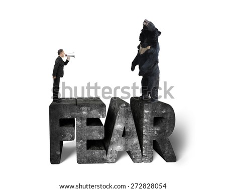 Businessman using megaphone yelling black bear at 3D mottled concrete fear word, isolated on white background - stock photo