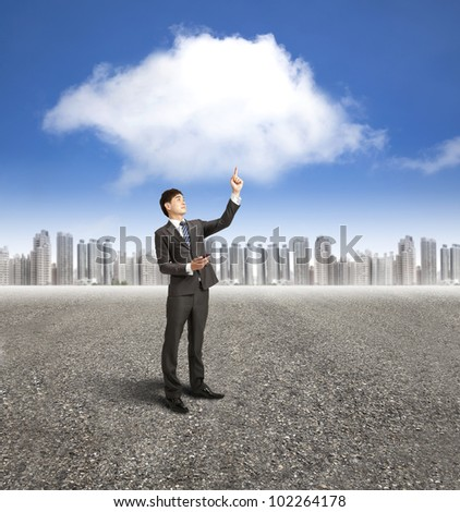 businessman using mobile phone with cloud computing and application concept - stock photo