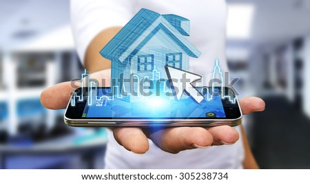 Businessman using mobile phone with digital house and city - stock photo