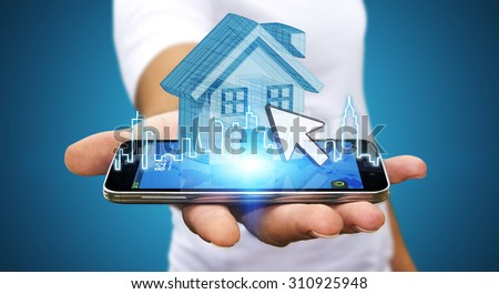 Businessman using mobile phone with digital house and city