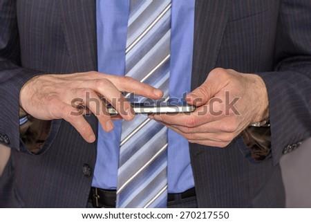 Businessman using mobile smart phone, close up - stock photo