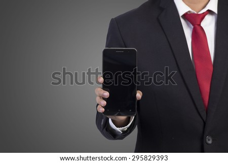 businessman using mobile smart phone on grey background