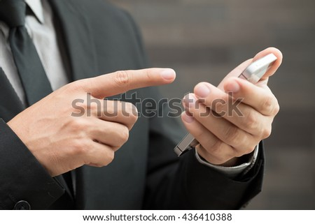 Businessman using mobile smartphone