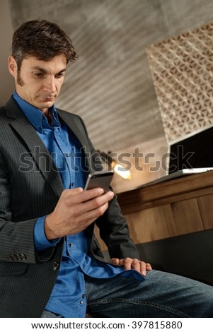 Businessman using mobilephone, dialing. - stock photo