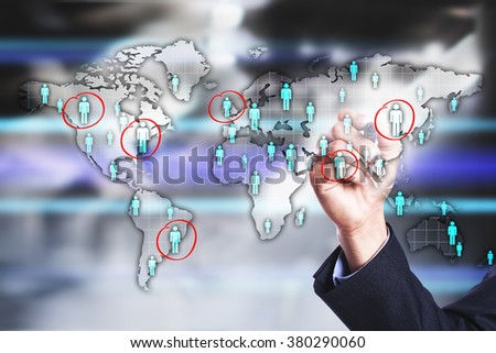 businessman using  modern computer and drawing world map with people icons  on the virtual screen. business, internet and. tehnology concept.