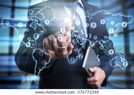 businessman using modern computer and pressing button on virtual screen with world map. global recruitment. global outsourcing. social networks.. business, technology and internet concept. - stock photo