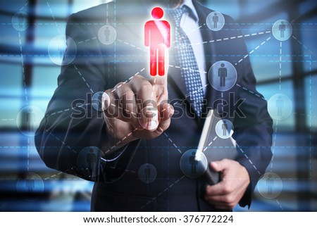 businessman using modern computer and pressing people icon on virtual screen. Teambuilding, leadership, hr, human resources business, technology and internet concept. - stock photo