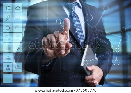 businessman using modern computer, pressing button on virtual screen. business strategy concept. internet, networking and technology concept.  - stock photo