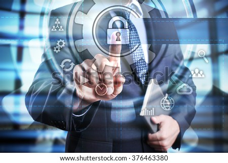 Businessman using modern computer, pressing security button on virtual screen. business, technology and internet concept. - stock photo