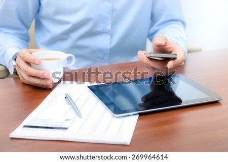 Businessman using new technologies for success workflow - stock photo