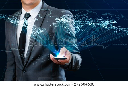 businessman using smart phone making global connection - stock photo