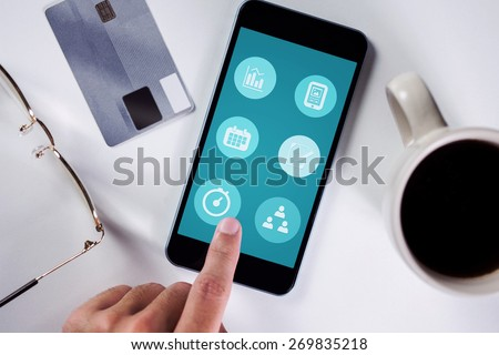Businessman using smartphone against fitness apps - stock photo