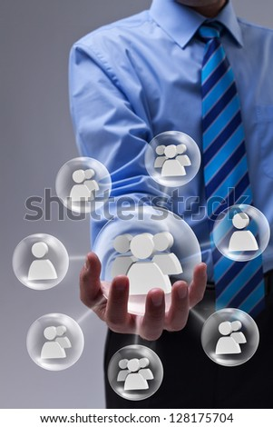 Businessman using social networking as a marketing tool - stock photo