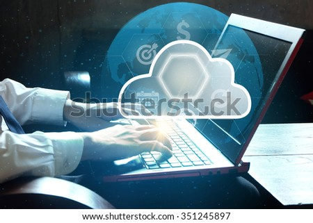 Businessman using software programs from laptop flying icons with cloud , business concept , business idea
