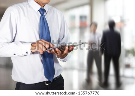 Businessman using tablet in the office  - stock photo