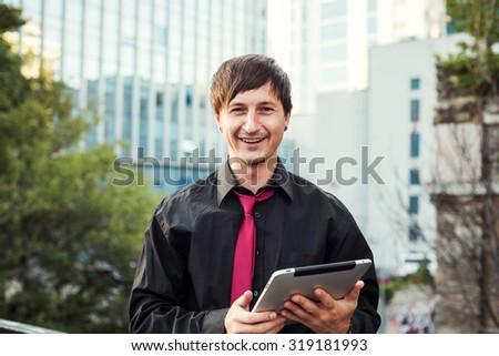 businessman using tablet outdoors