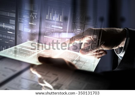 Businessman using tablet over virtual interface background