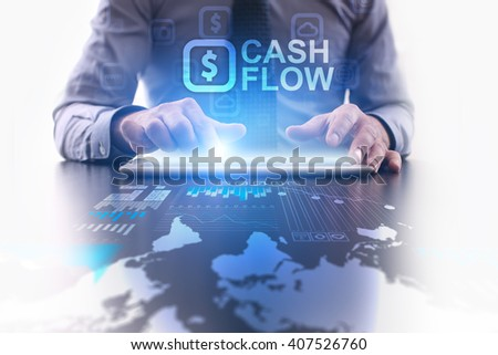 Businessman using tablet pc and select Cash flow. - stock photo