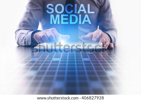 Businessman using tablet pc and select Social Media. - stock photo