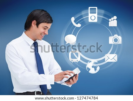 Businessman using tablet with applications on blue background - stock photo