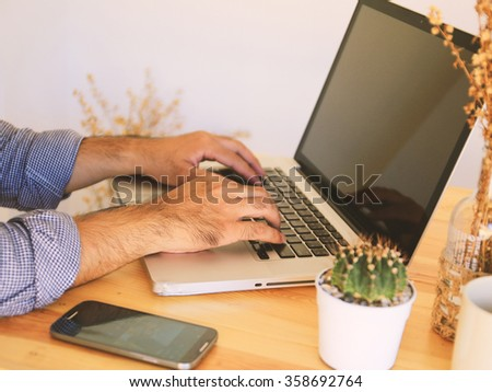 Businessman using the new media technology. laptop,smartphone - stock photo