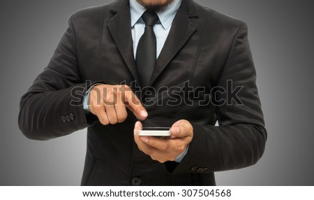 Businessman using the smart phone on gray background, include clipping path